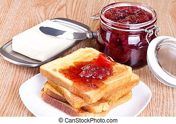 Toast with strawberry jam and butter