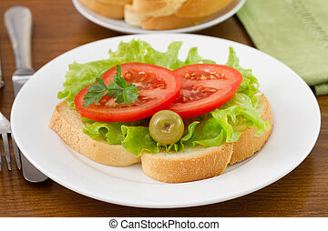 toast with vegetables on the white plate