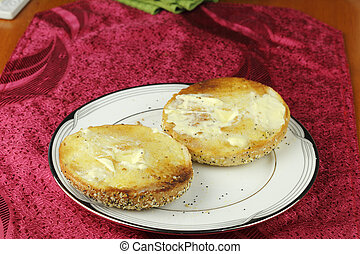 Toasted and Buttered Everything Bagel on a Plate