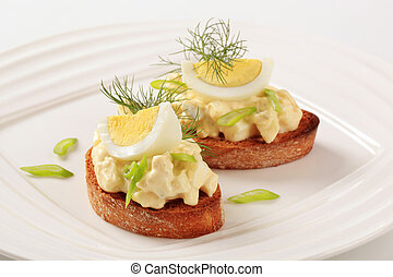 Toasted bread and egg spread - Slices of toasted bread and ...
