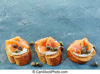 toasted bread with salmon fillet and cream cheese