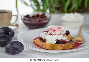 Toasted French bread with curd cream and plum jam. The ...