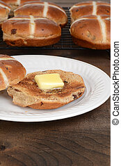toasted hot cross bun with butter