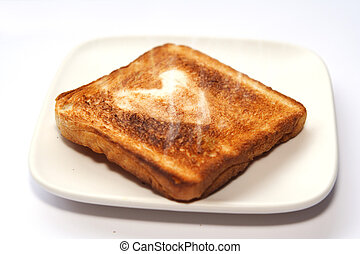 Toasted Love - a toasted bread with a heart-shaped symbol in...