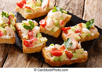 Toasted sandwiches with lobster, avocado, tomatoes and cream cheese close-up on the table. horizontal, rustic