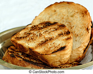 Toasted sliced white bread in metal