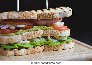 Toasted Triple Decker Club Sandwich with chicken, bacon