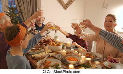 Toasting At Christmas Dinner - Family are toasting their...
