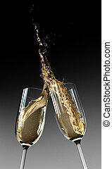 Toasting Champagne Flutes - Two Champagne glasses clinking...