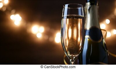 Toasting Champagne with holiday Bokeh Blinking Background. 4k footage