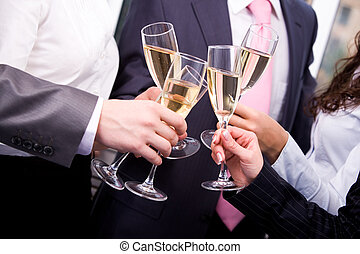 Toasting - Close-up of human hands cheering up with flutes...