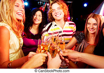 Toasting friends - Portrait of group of happy young people...