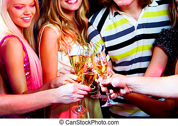 Toasting - Portrait of boozing young people toasting at...