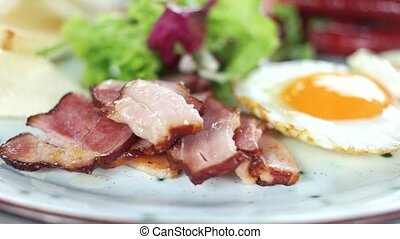 Toasts, bacon and eggs. High calorie breakfast.