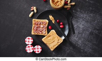 Toasts bread with homemade peanut butter served with fresh...