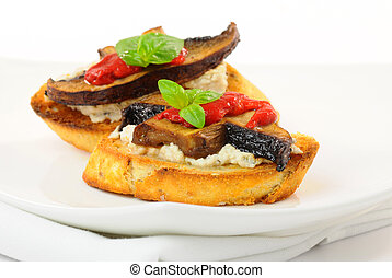 Toasts with ricotta, mushroom and roasted red peppers.