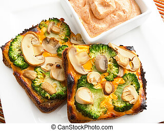 Toasts with broccoli and mushrooms