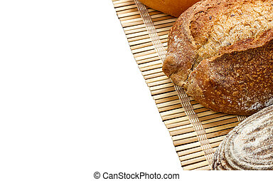 Toasty Organic Loaf of French Bread on wooden plank isolated on white