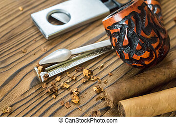 tobacco pipe with tobacco and cutter