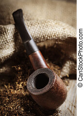 Tobacco - Vintage image of tobacco pipe on wooden background