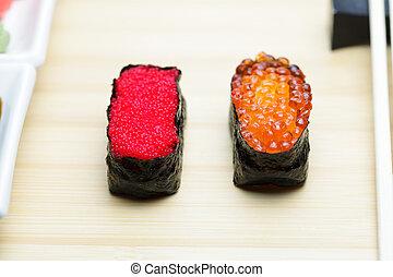 Tobiko and Ikura sushi on table - Tobiko and Ikura sushi on ...