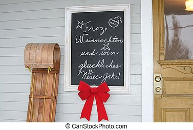 Toboggan and frame with greetings