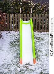 Toboggan covered with snow in a garden