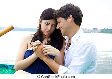 Woman forgiving smiling husband