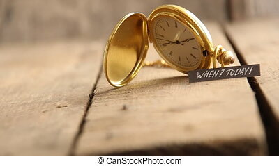 Today idea, text and gold pocket watch.