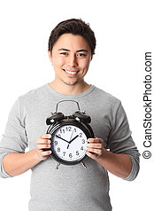 Today its time! - Young attractive man holding a clock....