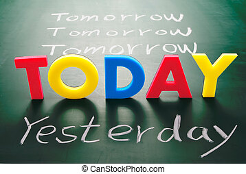 Today, yesterday, and tomorrow words on blackboard, Time...
