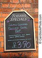 Todays Specials board. - Todays Special chalkboard against a...
