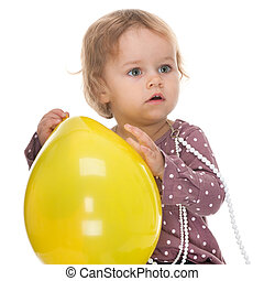 Toddler and a yellow balloon