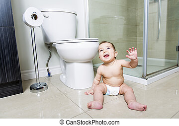 Toddler baby toilet in bathroom - A Toddler ripping up...
