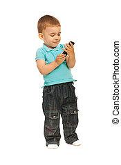 Toddler boy holding a cellphone