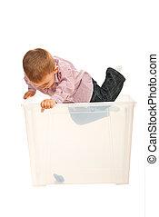 Toddler boy jump in a box