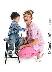 Toddler Boy Listening To Nurse's Heart - Toddler boy...