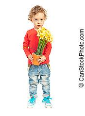Toddler boy offering flowers
