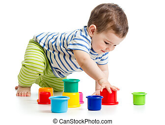 toddler boy playing with cup toys