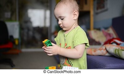 Toddler Boy playing with toy car