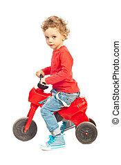 Toddler boy riding bicycle