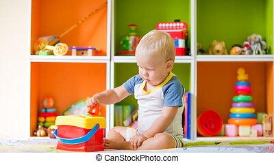Toddler boy solves sorter puzzle - Toddler boy finds block...