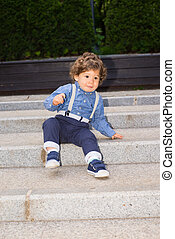 Toddler boy trying to descend stairs