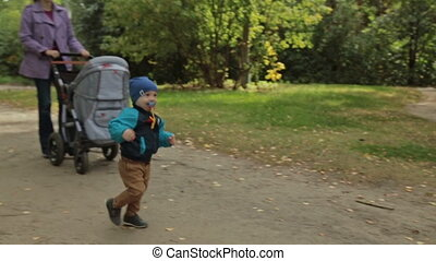 Toddler boy walking in the park, slowmotion