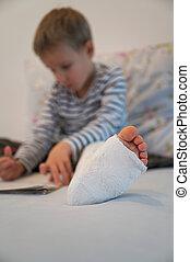 Toddler boy with broken leg in a cast.
