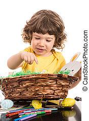 Toddler boy with Easter basket