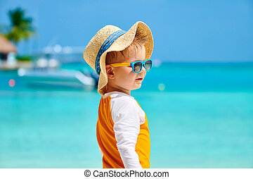 Toddler boy with sunglasses on beach