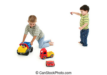 Toddler Boys Playing - Two toddler boys running around with...