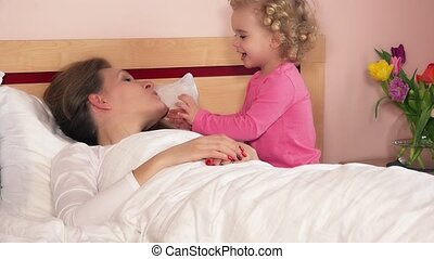 toddler daughter awake sleeping mother mom in bed