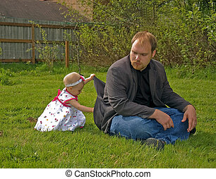 Toddler Getting Into Daddy\'s Pockets